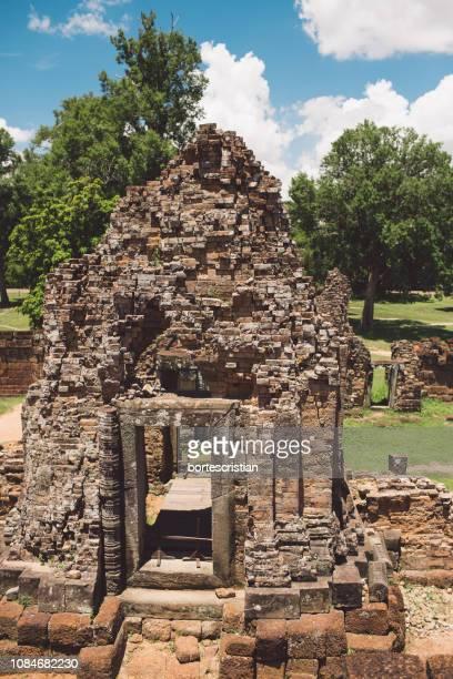 view of old ruins against trees - bortes photos et images de collection