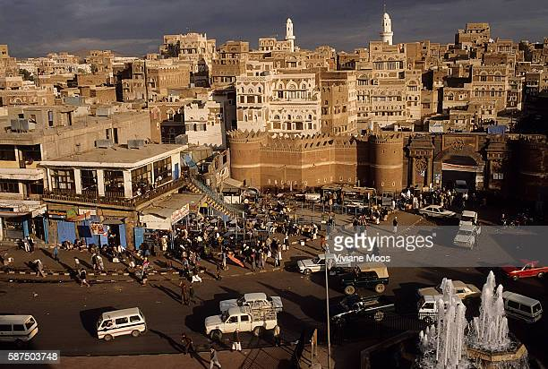 View of old Sanaa over the traffic, fountains and the square in front of the Bab al-Yaman , an iconized entry point through the city walls that is...