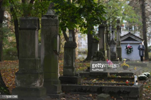 A view of old tombs at Old cemetery in Rzeszow on All Saints' Day On the 1st November All Saints Day many people in Poland pay respects to dead...