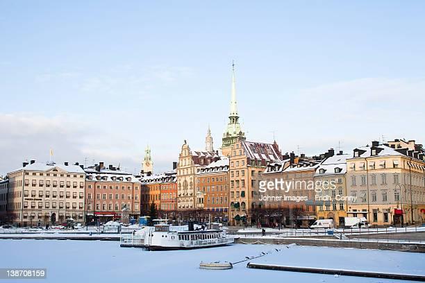 view of old town in winter - stockholm stock-fotos und bilder