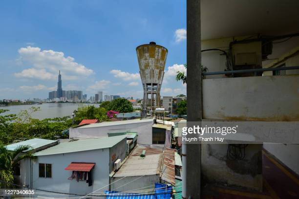 view of old water tower and landmark 81 building from an old apartment - saigon river stock pictures, royalty-free photos & images