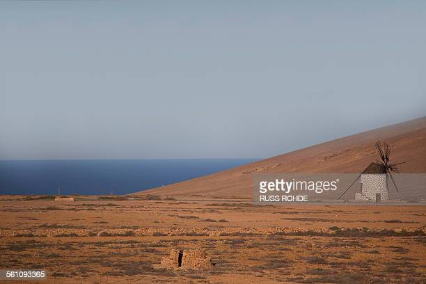 View of old windmill and sea, Fuerteventura, Spain