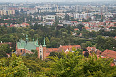 View of Oliwa Cathedral, Oliwa district and beyond in Gdansk, Poland, from above.