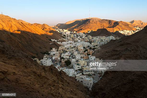 view of oman's capital city, muscat, at sunrise. - image stock pictures, royalty-free photos & images