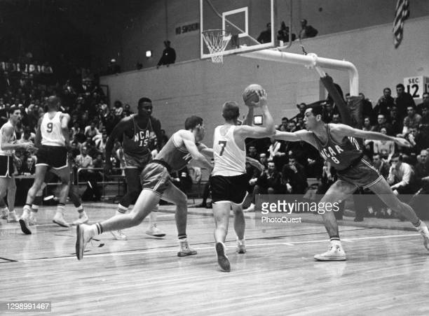 View of on-court action in a basketball game during tryouts for the 1964 US Olympic Basketball team, New York, New York, April 1964. Among those...