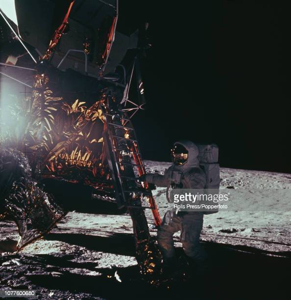 View of one of the Apollo 12 astronauts either Commander Pete Conrad or Lunar Module pilot Alan Bean standing at the bottom of the Lunar Module...