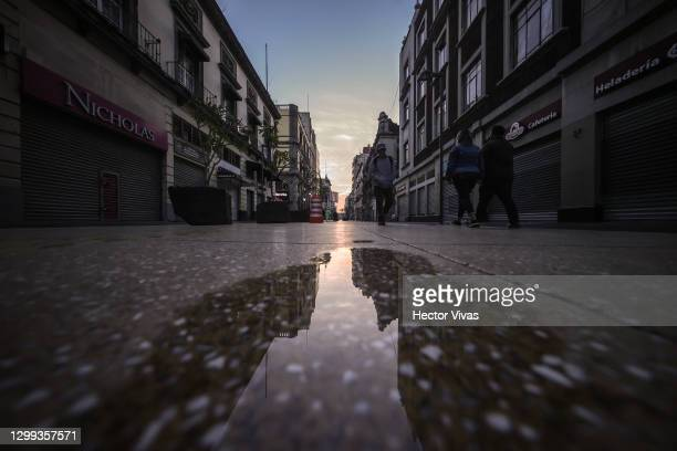 View of one of the downtown streets while people walk on January 29, 2021 in Mexico City, Mexico. As death toll in the country becomes the world's...