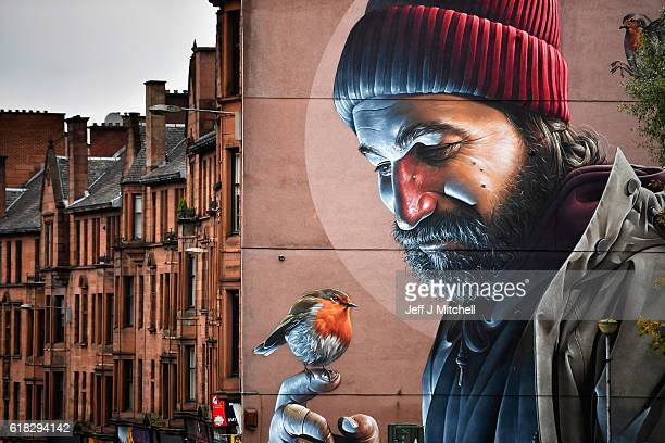 A view of one of the latest murals near Glasgow cathedral on October 26 2016 in Glasgow Scotland The murals have been appearing across the city for a...