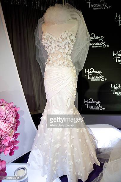 A view of one of three wedding dresses designed by Simin Haute Couture for Kim Kardashian wax figure displayed at Kim Kardashian wax figure unveiling...