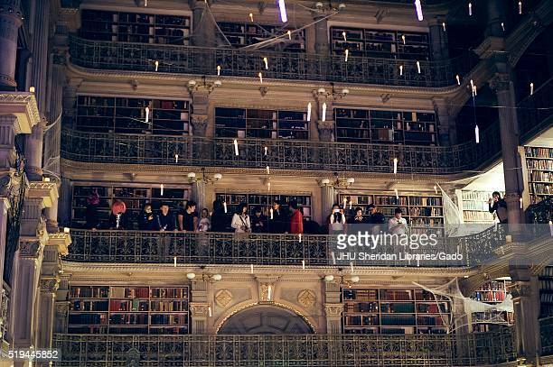 View of one side of the upper levels of the George Peabody Library at Johns Hopkins University, students are on one of the levels, 2015. Courtesy...
