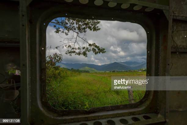 view of organic paddy fields from the wreck of a scottish aviation twin pioneer aircraft in bario, sarawak - a well known place as one of the major organic rice supplier in malaysia. - shaifulzamri stock-fotos und bilder