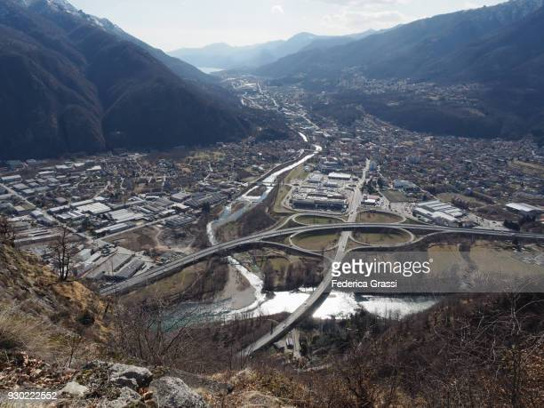 view of ossola valley, toce river and orta lake, seen from the top of mount montorfano - distrito industrial - fotografias e filmes do acervo