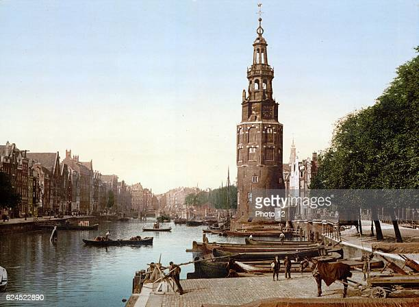 View of Oude Schans , Amsterdam, Holland. The Montelbaanstoren, built in 1512, housed the city's military guard and is part of Amsterdam's old...