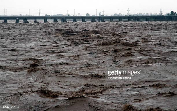 A view of over flooded river Tawi during heavy rain and flash floods on September 6 2014 in Jammu India The region has been hit by its worst monsoon...