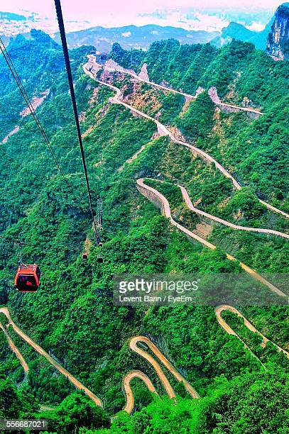 View Of Overhead Cable Car Crossing Hills