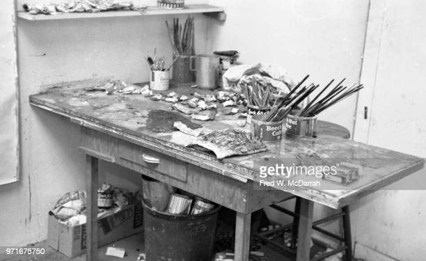 View of paints brushes and other supplies on a table in artist Philip Guston's studio New York New York April 14 1961