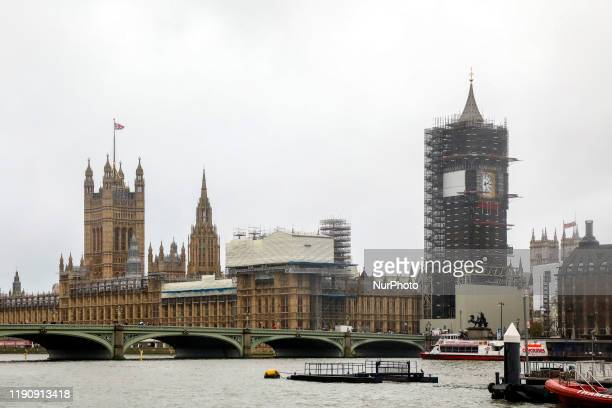 View of Palace of Westminster and Big Ben covered in scaffolding during renovation. London, United Kingdom on 12 December, 2019.