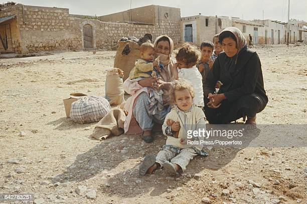 View of Palestinian Arab women and children sitting and crouching inside the Jabalia refugee camp in the Gaza Strip territory on 25th April 1969.