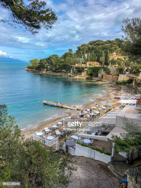 view of paloma beach in april, on the east coast of cap-ferrat near the village of saint-jean-cap-ferrat, french riviera, france - saint jean cap ferrat stock pictures, royalty-free photos & images