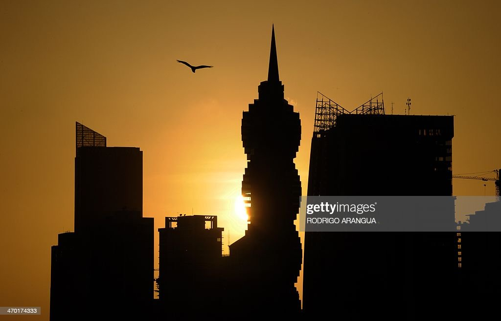 View of Panama City during sunset on February 18, 2014. AFP PHOTO / Rodrigo ARANGUA