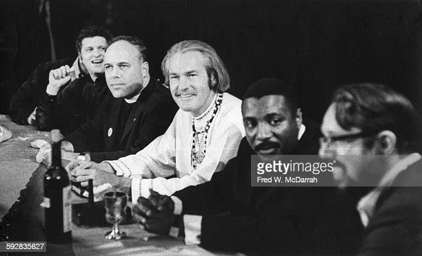 View of panelists on stage during 'An Evening with God' onstage at the Fillmore East New York New York May 13 1967 Pictured are from left American...