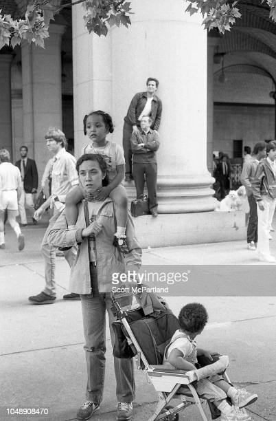 View of parade spectators on a street in Lower Manhattan during the Brooklyn Bridge's 100th birthday celebrations New York New York May 24 1983