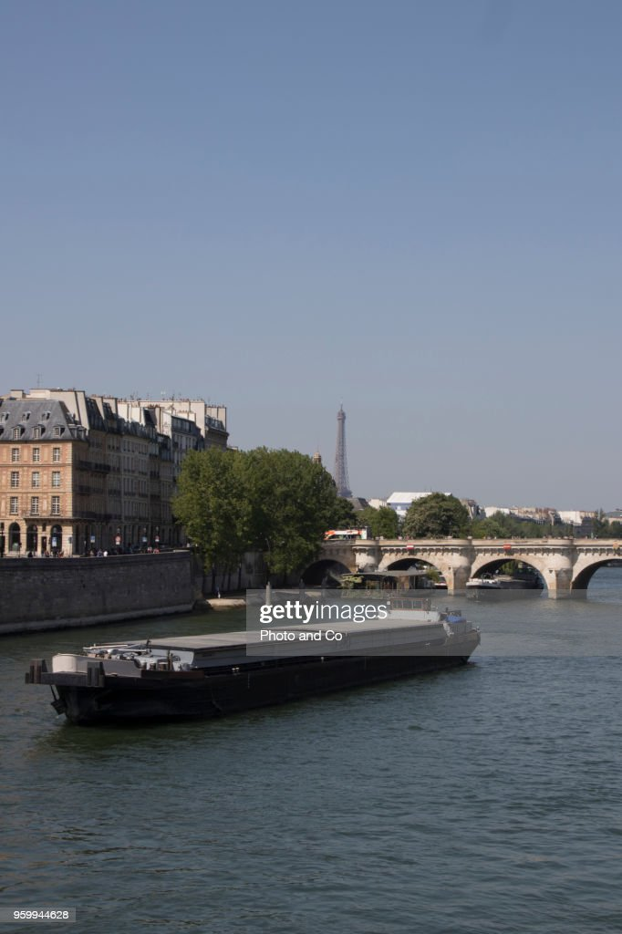 view of Paris, barge on the Seine in front of the Pont Neuf : Stock Photo