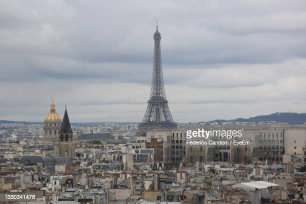 view of paris city with eiffel tower and les invalides monument with golden dome - les invalides quarter stock pictures, royalty-free photos & images