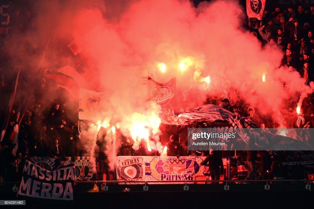 A view of Paris Saint-Germain supporters cheer with flares during the Ligue 1 match between Paris Saint Germain and Olympique Marseille February 25, 2018 in Paris, France.