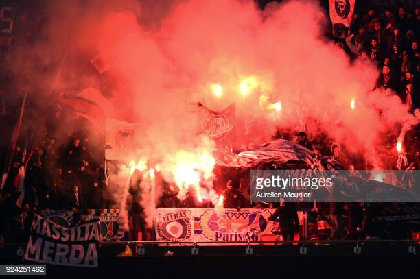 A view of Paris SaintGermain supporters cheer with flares during the Ligue 1 match between Paris Saint Germain and Olympique Marseille February 25...