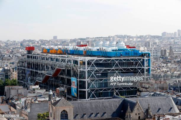 A view of Paris taken from the top of the Tour SaintJacques during its reopening after renovation shows the Centre Georges Pompidou on July 7 2017 in...
