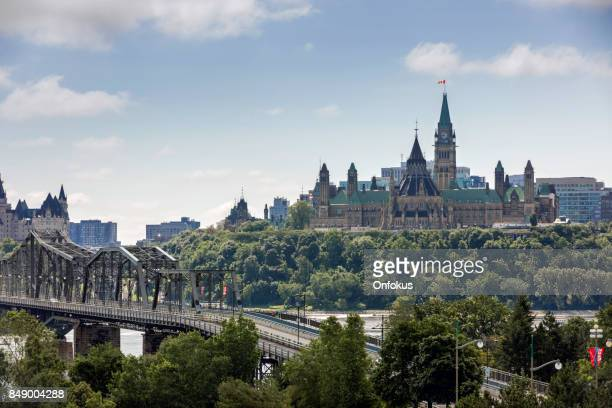 view of parliament hill from ottawa river, canada - gatineau stock pictures, royalty-free photos & images