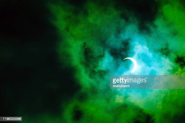 view of partial annular solar eclipse in kuala lumpur with dramatic colour. - shaifulzamri stock pictures, royalty-free photos & images