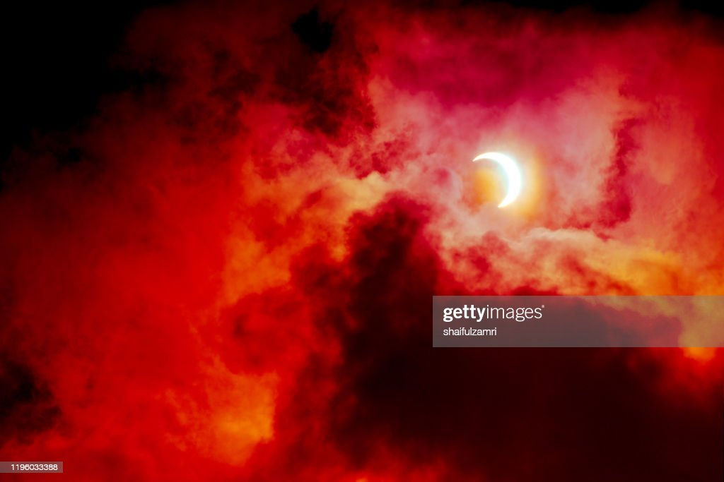 View of partial annular solar eclipse in Kuala Lumpur with dramatic colour. : Stock Photo