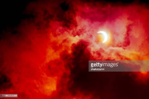 view of partial annular solar eclipse in kuala lumpur with dramatic colour. - shaifulzamri foto e immagini stock