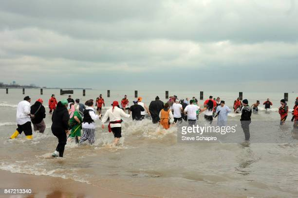 View of participants in a Chicago Polar Plunge event as they run into Lake Michigan Chicago Illinois 2010