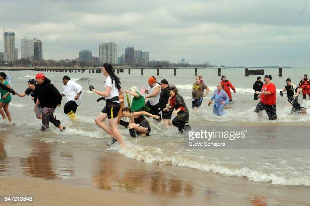 View of participants in a Chicago Polar Plunge event as they run out of Lake Michigan Chicago Illinois 2010
