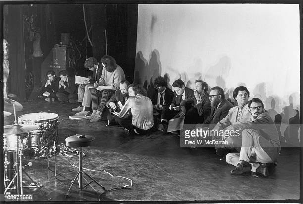View of participants sitting on the ground at a poetry reading at the Village Theatre New York New York May 18 1967 Among those pictured are from...