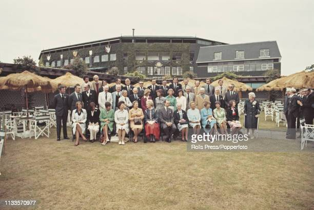 View of past Wimbledon Championships winners pictured together at the start of the 1977 Wimbledon Championships at the All England Lawn Tennis and...