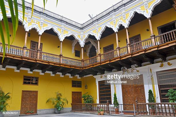 View of Patio of Palacio de Torre Tagle with wood balcony and andaluz architectural details. Torre Tagle Palace is a mansion that was constructed at...