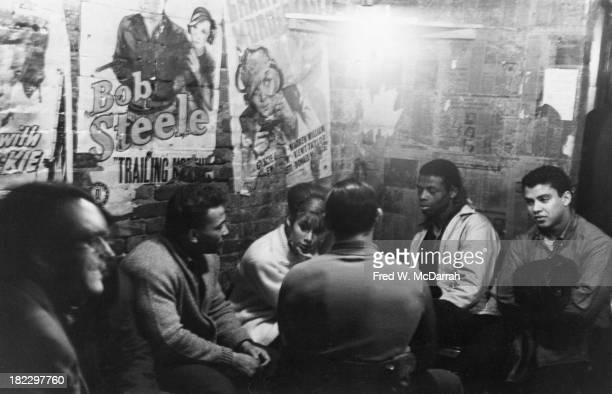 View of patrons at a table in the Cafe Fiagro downstairs lounge New York New York November 13 1965