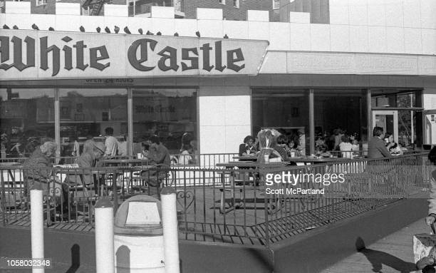 View of patrons at a White Castle fast food restaurant as they dine at the outdoor patio on Queens Boulevard in Queens New York New York September...
