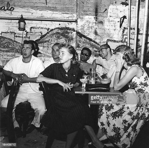 View of patrons at the Cafe Bizarre as they listen to Beat poets New York New York June 7 1959