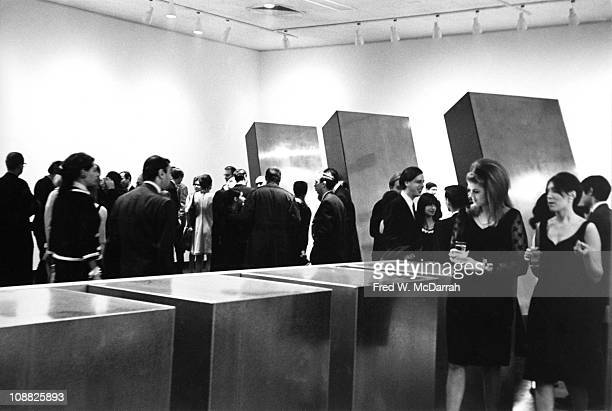View of patrons at the Primary Structures' exhibition ar the Jewsih Museum New York New York April 26 1966 Among the visible works are sculptures by...