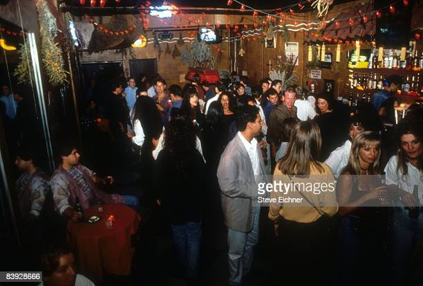 View of patrons milling about in the bar area of New York City's Webster Hall, 1993.