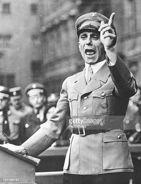 View of Paul Joseph Geobbels , Nazi propaganda minister, gesturing to a crowd during a speech, early to mid twentieth century.