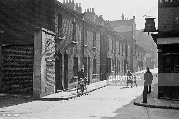 A view of pedestrians and a street corner pub in Prusom Street Wapping east London December 1949 Original Publication Picture Post 4931 The Pool Of...