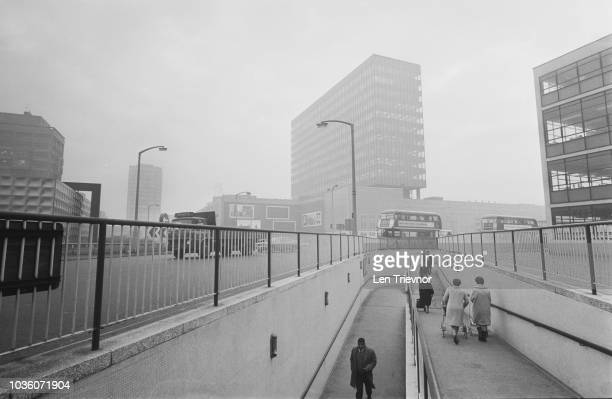 View of pedestrians and local residents walking down a ramp to an underpass under the recently redeveloped Elephant and Castle roundabout in South...