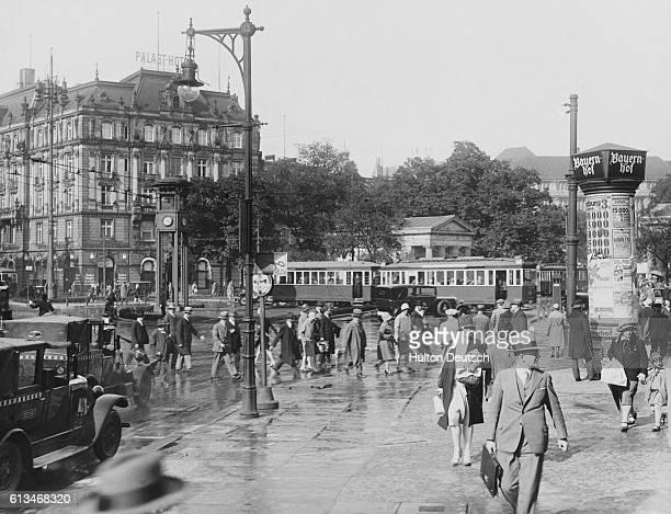 A view of pedestrians and trams in Berlin's Potsdamer Platz