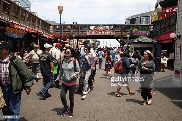 View of pedestrians at Pier 39 an outdoor mall and tourist attraction San Francisco California July 16 2014